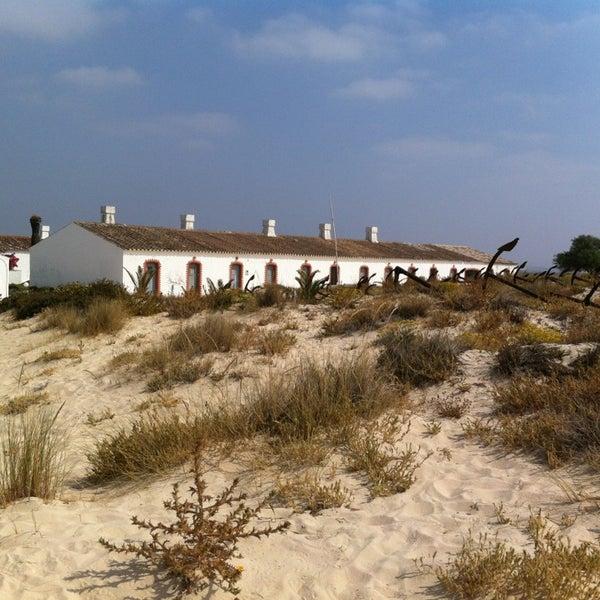 Photo taken at Praia do Barril by María M. on 7/12/2013
