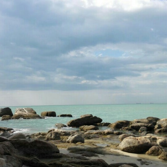 Photo taken at Teluk Bahang Beach by Auwatif A. on 2/27/2016