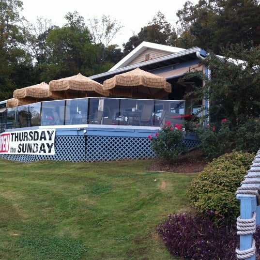 Photo taken at Fish Tales Lakeside Grille by Nathan K. on 10/18/2012