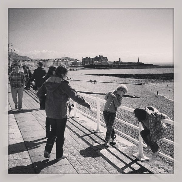 Photo taken at Aberystwyth Beach by Steve D. on 5/25/2013