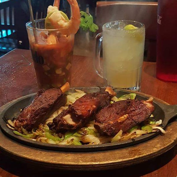 Love this plate called Redneck Fajitas . So tender it simply falls off the bone. And their margaritas are the best . They are made in a smoothie type machine. Great tasting!