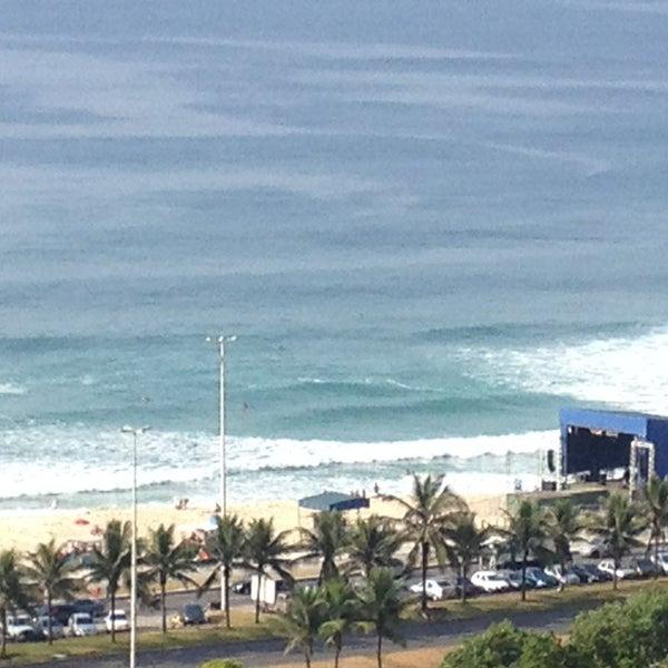 Photo taken at Praia da Barra da Tijuca by Lara C. on 12/31/2012