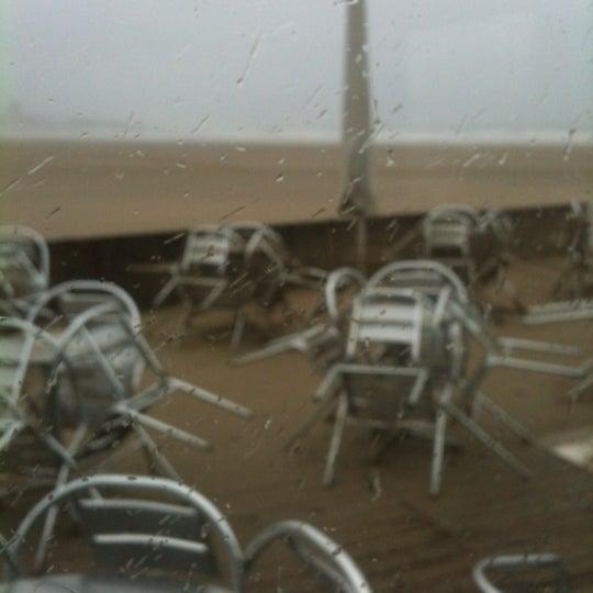 Photo taken at Praia do Titan by Pedro C. on 12/14/2012