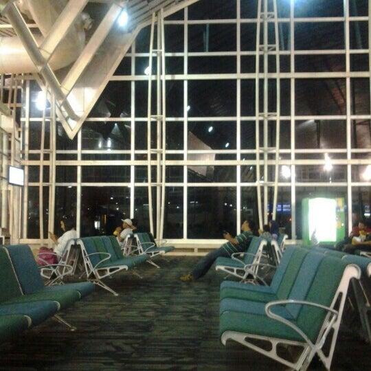 Photo taken at Sultan Hasanuddin International Airport (UPG) by Ririe G. on 3/30/2013
