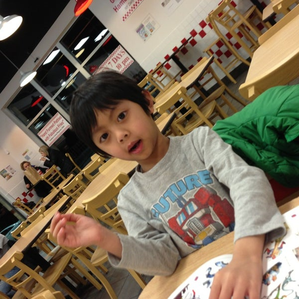 Photo taken at Five Guys by Erika E. on 2/19/2013