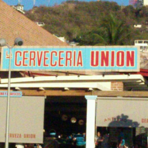 Photo taken at La Cerveceria Union by Jorge G. on 3/30/2013