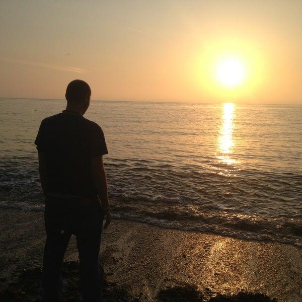 Photo taken at Aberystwyth Beach by Jose R. on 8/23/2013