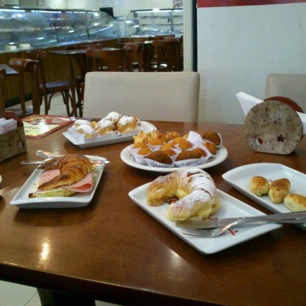 Photo taken at Confeitaria Barcelona by Anna Carolina M. on 5/26/2014