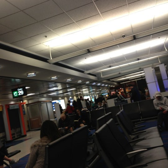 Photo taken at Gate C29 by Charlie R. on 4/6/2013