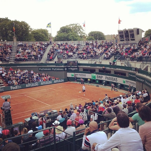 Photo taken at Stade Roland Garros by Lilou S. on 5/27/2013