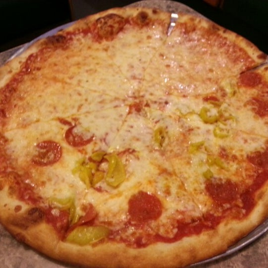 Photo taken at Toby's Original Little Italy Pizza by Victoria C. on 12/29/2012