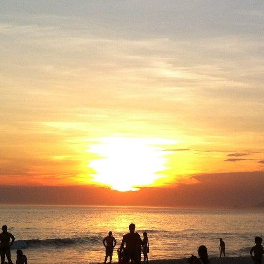 Photo taken at Praia da Barra da Tijuca by Alessandro D. on 12/7/2012