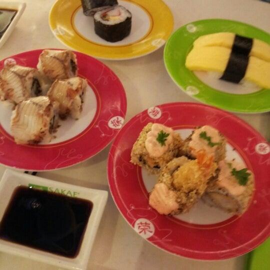 Photo taken at Sakae Sushi by ANH V. on 1/7/2013