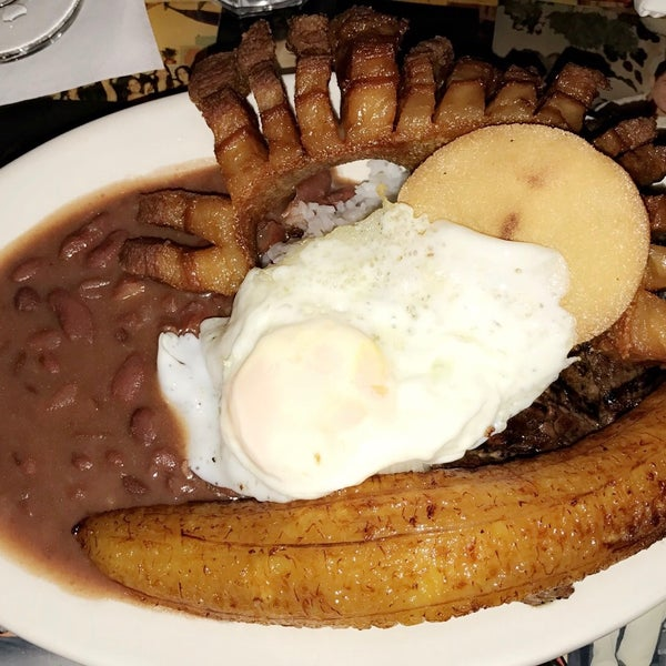 The food was absolutely delicious. The bandeja paisa was to die for. The portions are huge! The mojito was okay, not too amazing and kinda small. The decoration inside is beautiful. Really loved it.