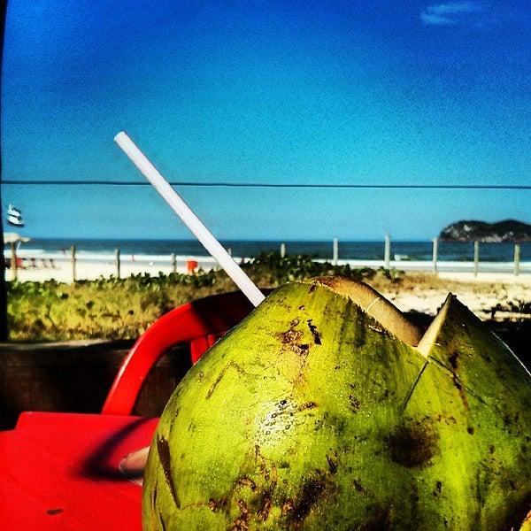 Photo taken at Praia da Barra da Tijuca by Leonardo S. on 8/8/2013