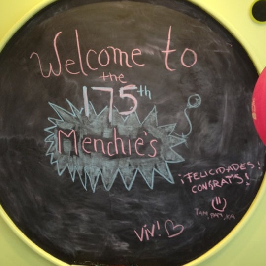 Photo taken at Menchie's Red Bug Village by Meredith B. on 4/21/2012