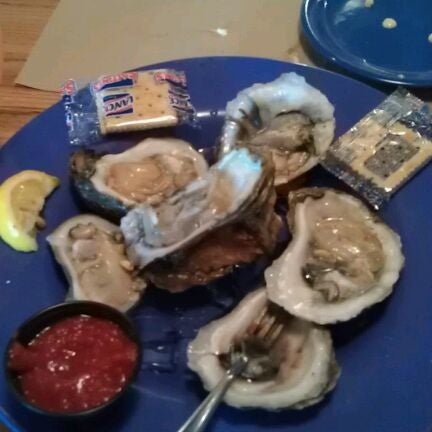 Photo taken at Boardwalk Billy's Raw Bar & Ribs by Brittany M. on 2/7/2012