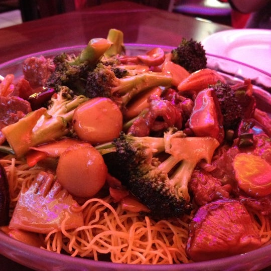 Photo taken at Shanghai Café Deluxe by Mikey B. on 2/21/2012