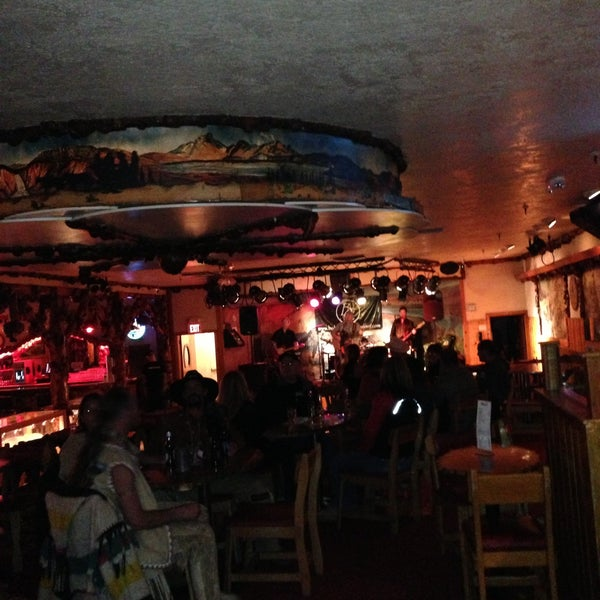 Photo taken at Million Dollar Cowboy Bar by Brandon B. on 5/27/2013