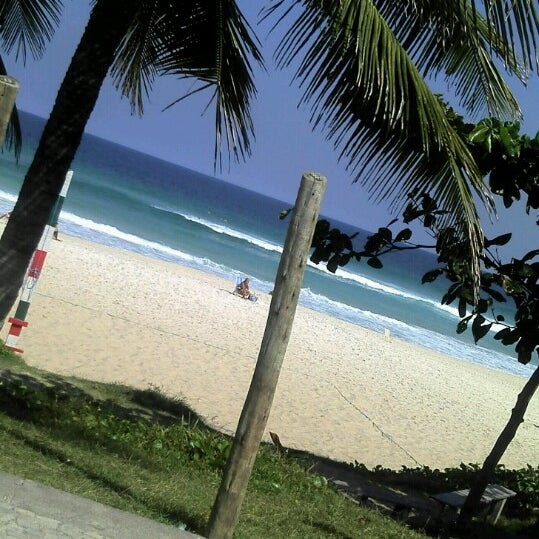 Photo taken at Praia da Barra da Tijuca by Sandra C. on 5/5/2013