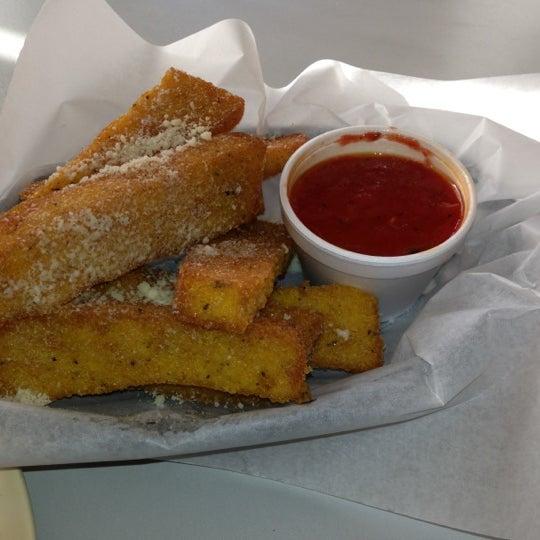 Photo taken at Regents Pizzeria by Carolina H. on 10/31/2012