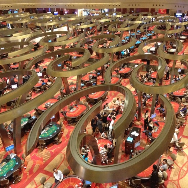 Photo taken at Marina Bay Sands Casino by Emin Y. on 3/11/2014