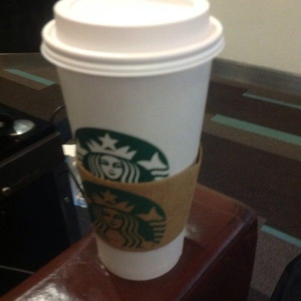 Photo taken at Starbucks by Edgar H. on 2/6/2014