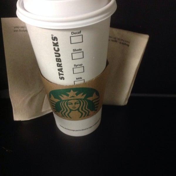 Photo taken at Starbucks by Edgar H. on 2/5/2014