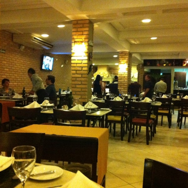 Photo taken at Canal 4 Restaurante e Pizzaria by Darrell C. on 4/6/2013