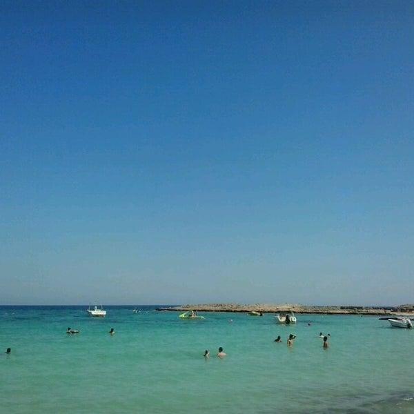 Photo taken at Makronissos Beach by Giorgio M. on 7/26/2013
