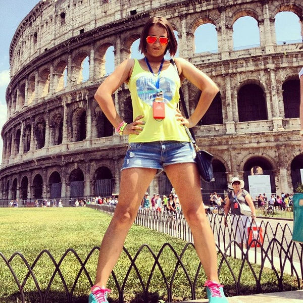 Photo taken at Piazza del Colosseo by ❤Julianna S. on 7/17/2013