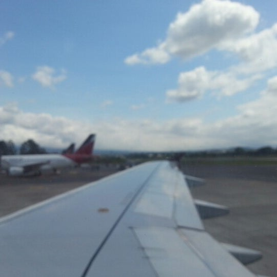 Photo taken at Gate 5 Aeropuerto Internacional Juan Santamaria by Juan M. on 11/4/2012