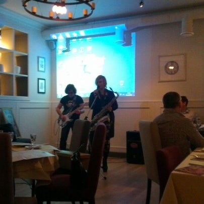 Foto tomada en Romeo's Bar & Kitchen por Ольга Ф. el 11/30/2012