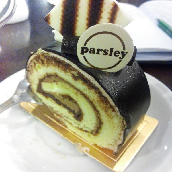 Photo taken at Parsley Bakery & Cake Shop by Axel T. on 9/17/2014