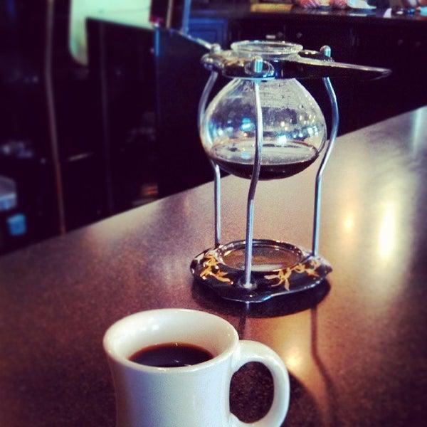 Photo taken at Arcedium Coffeehouse Inc by Ben K. on 10/27/2013