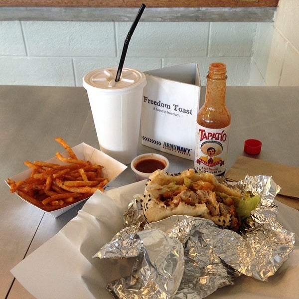 Photo taken at Army Navy Burger + Burrito by Jam F. on 3/4/2014