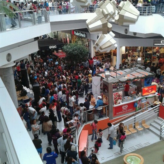 Photo taken at Centro Las Americas by Ana C. on 12/23/2012