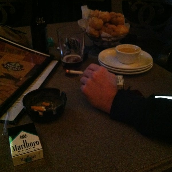 Photo taken at Green's Tavern by Haley P. on 1/4/2013