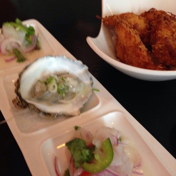 Photo taken at Masamoto Sushi & Asian Grill by Maya C. on 6/28/2014