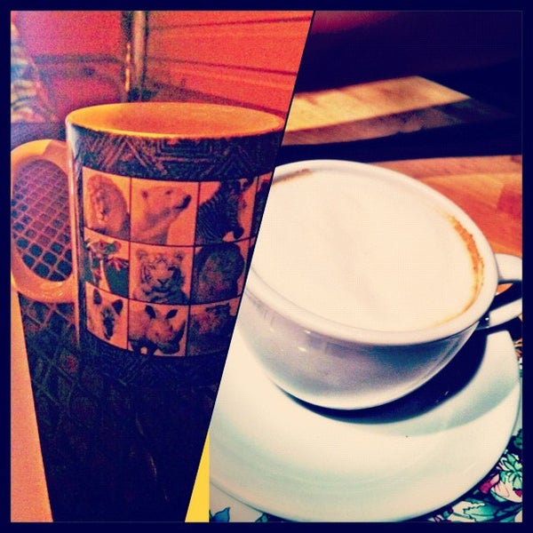 Photo taken at Bennu Coffee by Briana E. on 8/6/2012