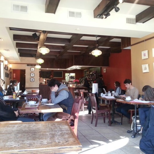 Photo taken at Tazza D'Oro Cafe & Espresso Bar by David G. on 12/14/2012