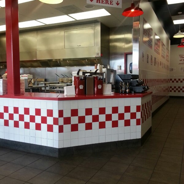 Photo taken at Five Guys by Cal L. on 3/6/2013