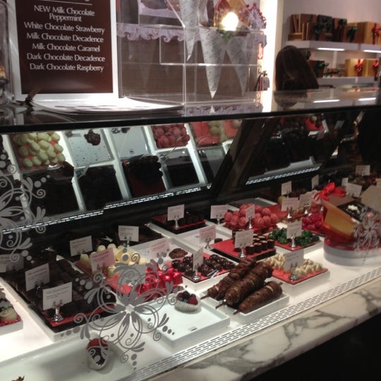 Photo taken at Godiva Chocolatier by Judy K. on 12/12/2012