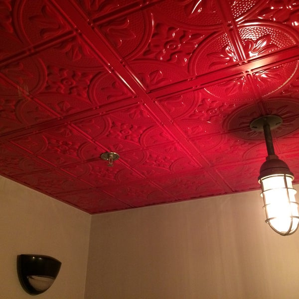 The ceiling in the men's room is shiny bright red.