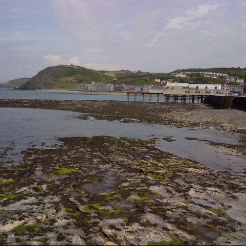 Photo taken at Aberystwyth Beach by Best of Wales on 6/19/2013