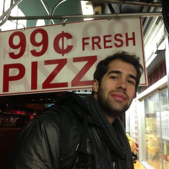 Photo taken at 99¢ Fresh Pizza by Leo Hideki O. on 12/2/2012