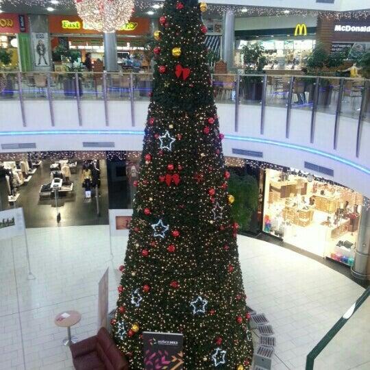 Photo taken at Atrium Optima by Alena L. on 12/23/2012