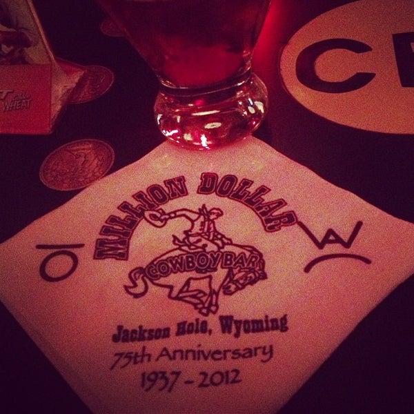 Photo taken at Million Dollar Cowboy Bar by Bonnie C. on 3/16/2013