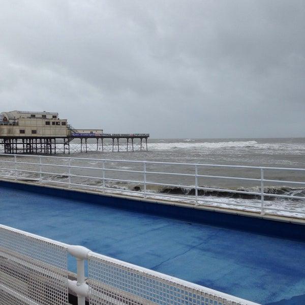 Photo taken at Aberystwyth Beach by Glenn R. on 10/27/2013
