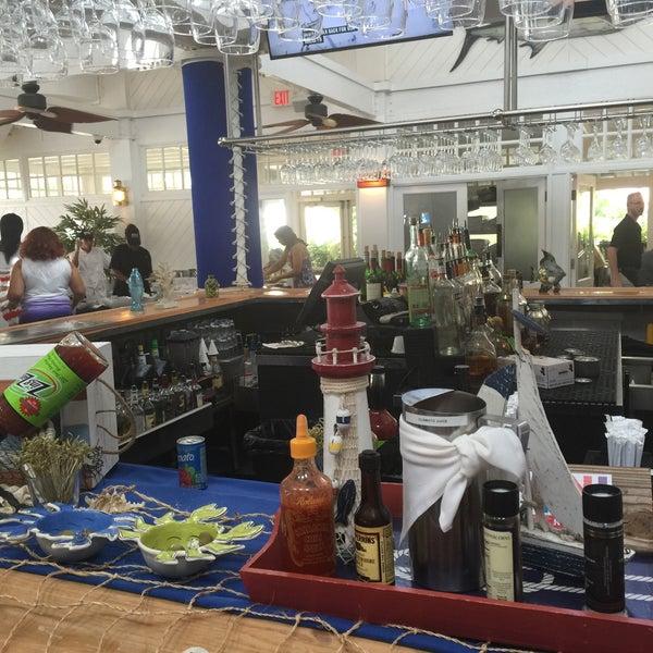 Photo taken at Bimini Boatyard Bar & Grill by Mjay P. on 5/11/2015
